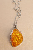Silver pear amber pendant Stock Photo