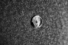 Silver peephole in luxury black iron door Royalty Free Stock Image