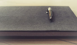 Silver Pen on Black Book Royalty Free Stock Photography