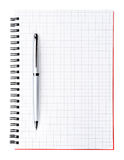 Silver pen on blank page of notebook, vertical. Silver pen on blank page of the notebook isolated on white Stock Image