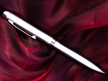 Silver pen at fabric Royalty Free Stock Photography