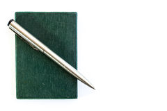 Silver pen and green notebook. On white background Royalty Free Stock Images