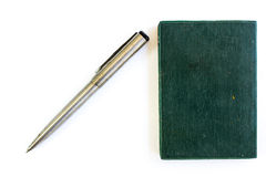 Silver pen and green notebook. On white background Stock Photos