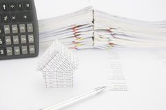 Silver pen and house on balance sheet Royalty Free Stock Photos