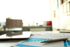 Silver pen lie at important paper on table. In empty office closeup. Paperwork job trade balance bank credit loan money invest payment irs commerce partnership stock image