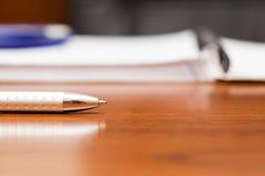 A silver pen near a notebook Stock Photography