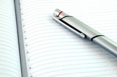 Silver Pen and New Agenda. Isolated Pen and New Empty Agenda - Ready To Write Stock Photos