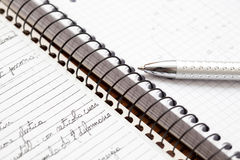 A silver pen on a notebook Royalty Free Stock Photos
