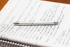 A silver pen on a notebook Royalty Free Stock Images