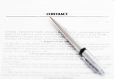 Silver pen on sheet of sales contract Stock Images