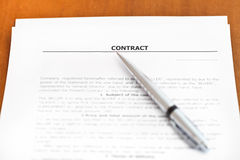 Silver pen on sheet of sales contract on table Stock Photos
