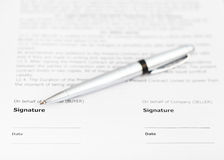 Silver pen on signature page of contract Stock Image