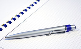 Silver pen and spiral notebook Royalty Free Stock Photos