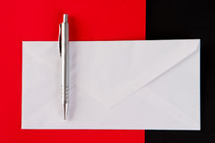 Silver pen and white envelope Stock Images