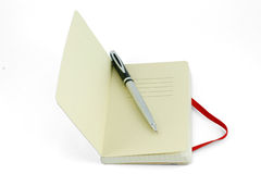 Silver pen on yellow front page of the notebook Royalty Free Stock Images
