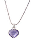 Silver pendant and blue heart shaped diamond. On white background royalty free stock photos