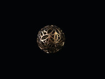 Silver pendant in the shape of ball. On a dark background Stock Photos