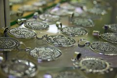 Silver pendants in Mexico. A display of silver pendants in a Mexican jewelry store Royalty Free Stock Photography