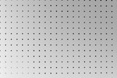 Silver perforated aluminum sheet, background Stock Images
