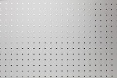 Silver perforated aluminum sheet, background Royalty Free Stock Photography