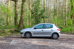 A 2001 silver Peugeot 206 in the woods stock photography