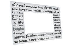 Silver photo frame with love poem. Embossed isolated over white background. Perspective view. Copyspace Royalty Free Stock Photo