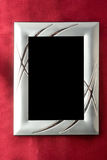 Silver photo frame over red silk Royalty Free Stock Photo