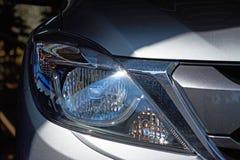 Silver pickup head light. Closeup. Big shiny pickup car headlight Royalty Free Stock Photos