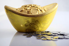 Silver piece. Golden color silver piece and some coins Stock Image