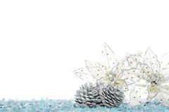Silver Pine Cone with christmas decoration flower on Snow Royalty Free Stock Photo