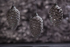 Silver pine cone ornaments with bokeh Stock Photography
