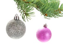 Silver, pink baubles on Christmas tree Royalty Free Stock Image
