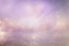 Silver and pink glitter vintage lights background. Defocused Royalty Free Stock Image