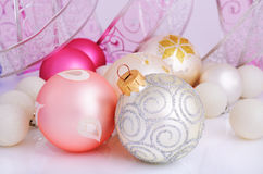 Silver, pink, purple and white Christmas balls. And Christmas ribbon on a light background horizontal stock photos