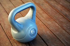 Kettle bell weight on wooden deck stock photo