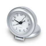 Travel clock. Silver plastic travel clock isolated on white with path royalty free stock photo