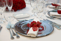 Silver plate with rose Stock Photos