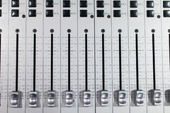 silver-plated brushed steel sound mixer with different sliding l royalty free stock photo