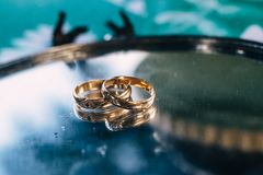 Silver platter with beautiful golden wedding rings stock photo