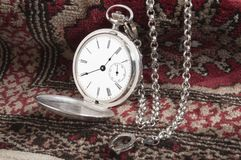 Silver pocket watch on carpet Stock Photography