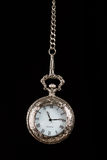 Silver pocket watch hang on chain Royalty Free Stock Photo