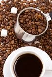 Silver pot and cup of coffee Stock Photography