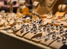 Silver and precious stones jewelry. Luxury silver and precious stones jewelry window shop display for sale Stock Images