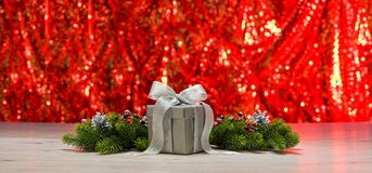 Silver present and Christmas tree branches Stock Photo
