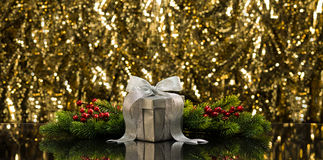 Silver present and Christmas tree branches Stock Images