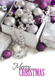 Silver and purple Christmas ornaments border Stock Image