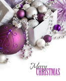 Silver and purple Christmas ornaments border Stock Photography