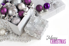 Silver and purple Christmas ornaments border Royalty Free Stock Images