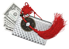 Silver purse with dollars and feng shui coin Royalty Free Stock Image