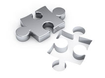 Silver puzzle. Over white background Stock Photos